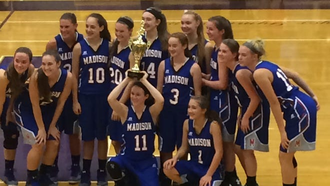 The Madison girls basketball team won the Knights Christmas tournament on Wednesday at North Henderson.