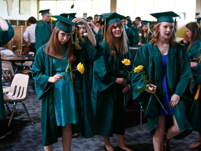 Graduating seniors get ready before the start of the 50th Regis High graduation at Regis High, in Stayton, on Sunday, June 8, 2014.