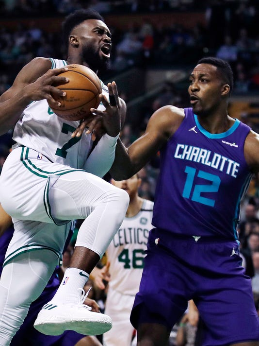 Charlotte Hornets center Dwight Howard (12) knocks the ball loose on a drive to the basket by Boston Celtics guard Jaylen Brown (7) during the first quarter of an NBA basketball game in Boston, Wednesday, Feb. 28, 2018. (AP Photo/Charles Krupa)
