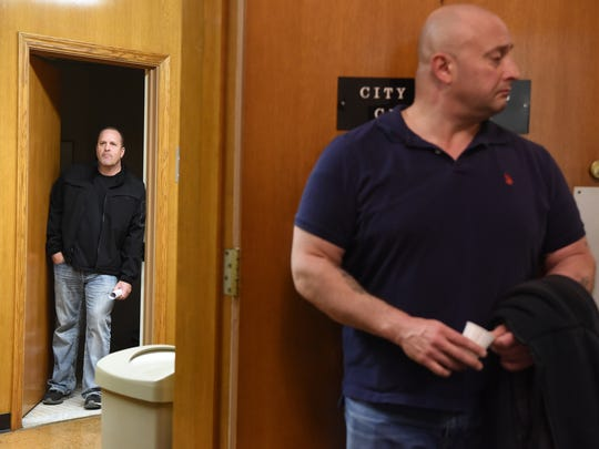 Retired Hackensack Lt. Scott Sybel, left, and former narcotics unit commander Vincent Riotto wait outside the City Council chambers during a Nov. 13 hearing.