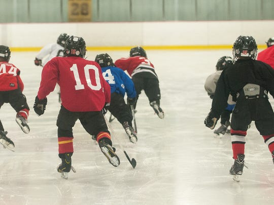 Youth players take on the ice during a practice at the Hollydell Ice Rink in Sewell.