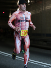 Santiago Sports Chiropractic team member Kevin Vrabel arrives out of the Lincoln Tunnel during the race in 2017.