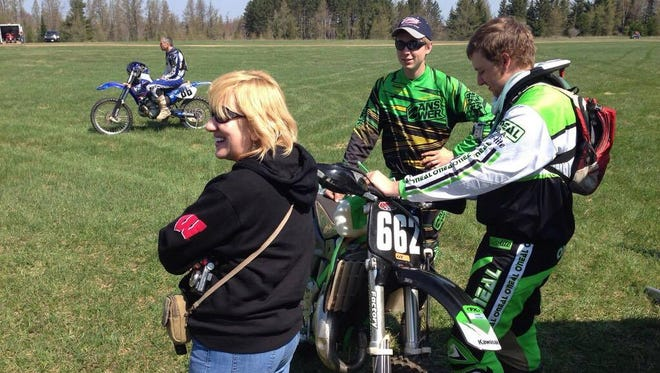 Brandon Normand, center, and his mom Carolyn, at a dirt bike event.