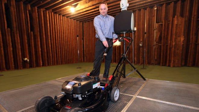 Briggs & Stratton Corp. acoustic engineer Brett Birschbach demonstrates the Quiet Power Technology mower at Briggs & Stratton Corp. in Wauwatosa in 2014.