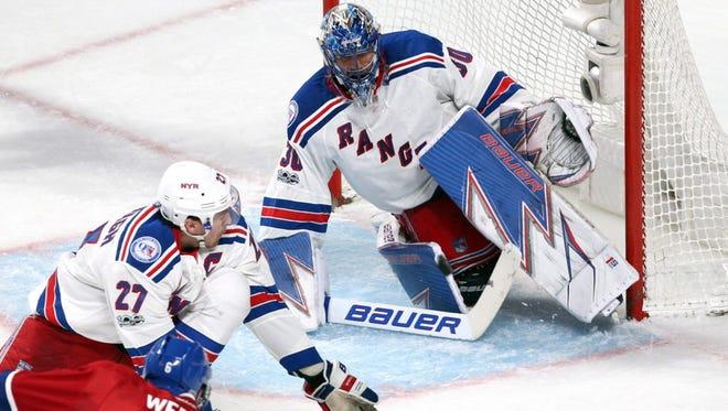Montreal Canadiens defenseman Shea Weber (6) shoots on New York Rangers goalie Henrik Lundqvist (30) as defenseman Ryan McDonagh (27) defends during the second period.