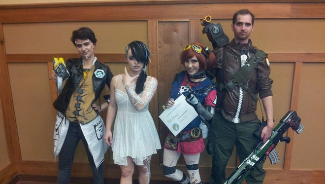 Cosplayers pose together during the 2016 Yama-Con. The 2017 event will go from Dec. 1-3 at the LeConte Center.