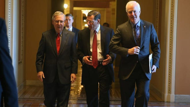 From left, Republican Sens. Mitch McConnell of Kentucky, John Barrasso of Wyoming and John Cornyn of Texas.