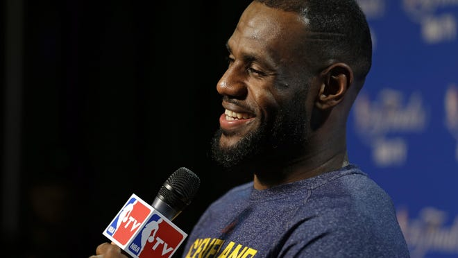 Cavaliers forward LeBron James answers a question during a press conference in Cleveland on Wednesday.