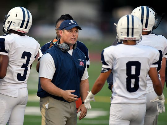West York coach Jeremy Jones (center) talks to his