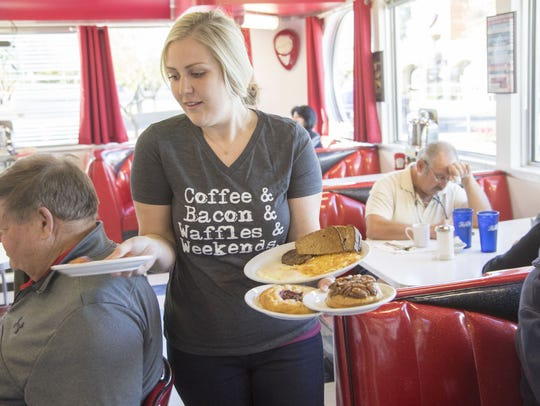Jennifer Chase serves breakfast at Chase's Diner, located