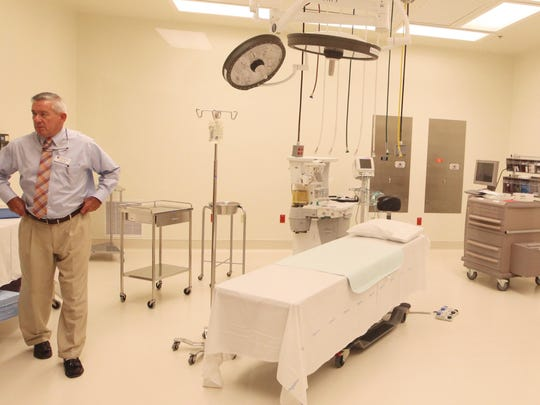 Promise Hospital of Fort Myers CEO Patrick Ryan walks through the operating room on Thursday.