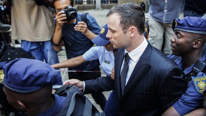 Oscar Pistorius leaves the High Court in Pretoria on Sept. 12, 2014.