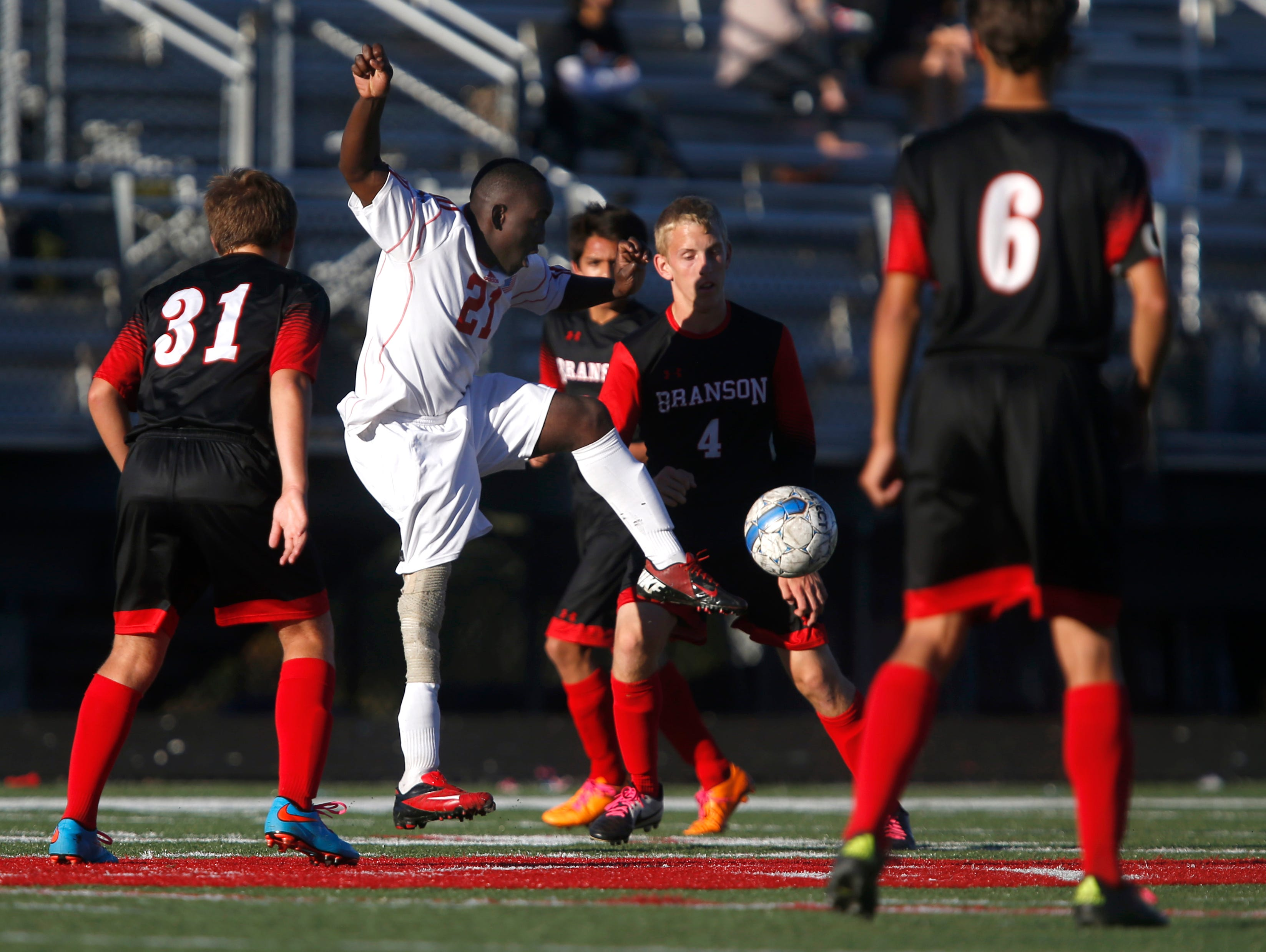 Glendale senior David Odun-Ayo kicks the ball with his left leg during a soccer game against Branson on Tuesday, Oct. 13, 2015. Odun-Ayo, who was born with proximal femoral focal deficiency, and is missing part of his right leg, runs and walks with a prosthetic leg is playing organized soccer for the first time.