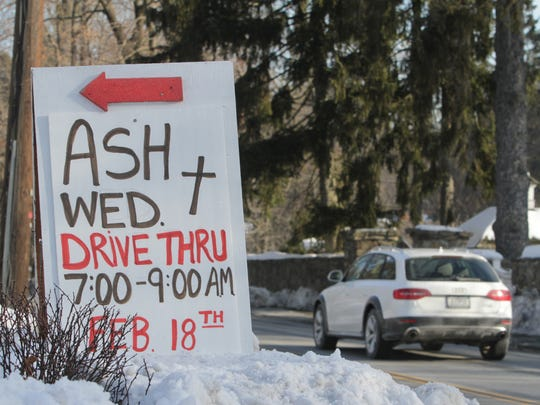 The sign for a drive-thru Ash Wednesday service at