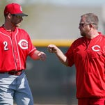 Cincinnati Reds shortstop Zack Cozart (2), left, who is recovering from a knee injury, gives Major League Strength and Conditioning Coordinator Sean Marohn, right, a fist bump at Cincinnati Reds spring training, Thursday, Feb. 25, 2016, in Goodyear, Arizona.