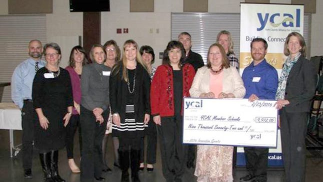Pictured, from left, are: Tom Laure, Joyce Marburger, Kellin McCullough, June Stratmeyer, Toni Shearer, Angela Jordan, Becki McCullough, Jenell McKowen, Matt Corwin, Melissa Halcott, Denise Fuhrman, Brian Heisey, and Beverly Evans. Chad Riddle and Jessica Rathell were not available for the photo.