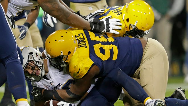 Green Bay Packers defensive end Datone Jones (95) tackles San Diego Chargers running back Danny Woodhead (39) inside the five yard line late in the fourth quarter at Lambeau Field on Oct. 18, 2015.