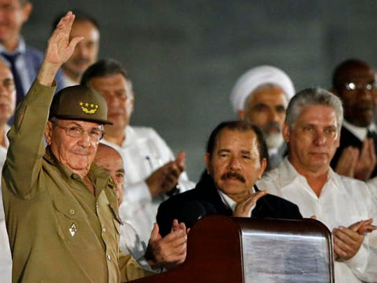 Cuba's President Raul Castro waves as he arrives to