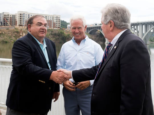 Lt. Governor Randy McNally, right, greets restauranteurs Mike Chase, left, and Bo Connor during a news conference  revealing the new vertical design of the Tennessee license and identificacation cards for people under 21.