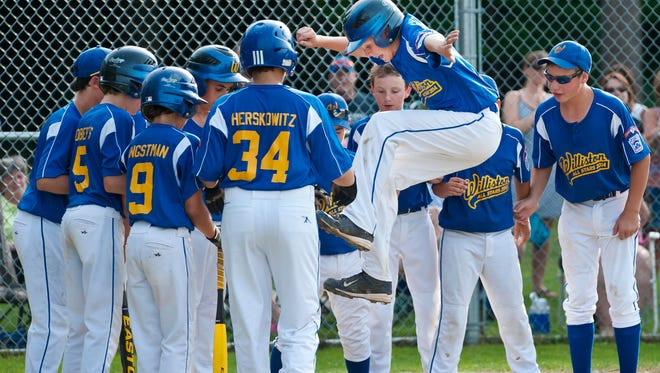 Williston's Griffin McDermott celebrates a home run against the Bennington All-Stars during the 11- and 12-year-old Little League state tournament at Schifilliti Park on Tuesday.
