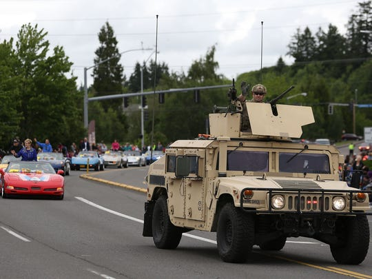 Hundreds of people participated in the Iris Festival Parade on Saturday, May 16, 2015, in Keizer, Ore.