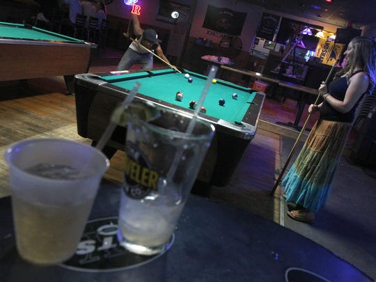 Winston Prendergast of Neptune and Erin Graham of Tinton Falls play a game of pool at PK's Shamrock Pub in Lake Como.