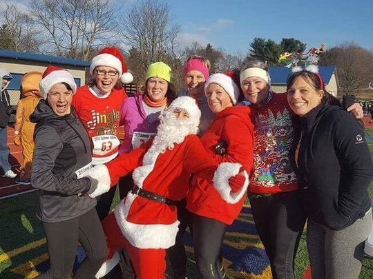 Several area runners, and another from the North Pole, took part in the Caring 4 Kids Jingle Bell 5K last weekend.