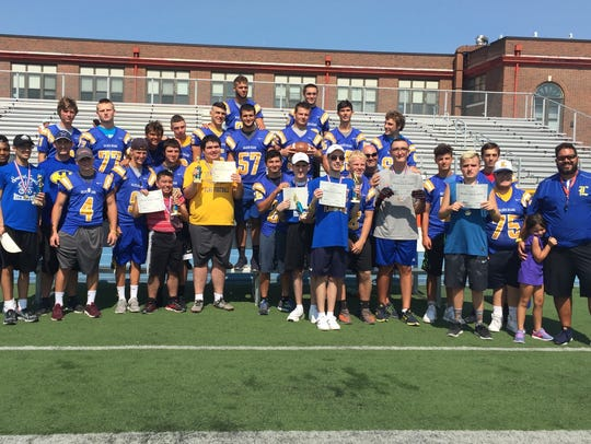 The Special Angels and their mentors at the kick, punt