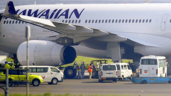 A Hawaiian Airlines jet is seen at Tokyo's Haneda Airport