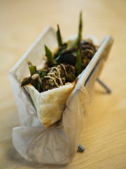 June 22, 2017 - The Cena Pita includes quinoa patties, mushrooms, asparagus and dijon mustard at Mama Gaia, located at 1350 Concourse Ave., Suite 137.