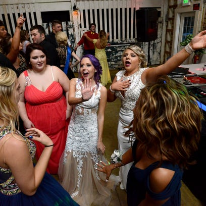 Prom goers dance at the Lancaster High School prom Saturday night, April 30, 2016, at Little Brook Meadows in Lancaster.
