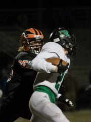 Iola-Scandinavia's Carter Snyder closes in on a Regis' ball carrier during a Division 6 semifinal from Goerke Field.