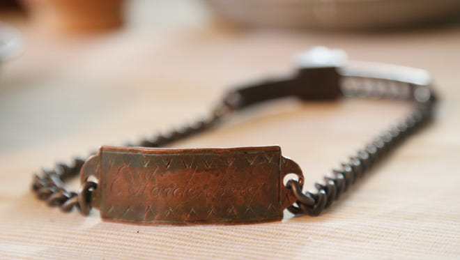 "A reproduction of a slave collar at Historic Huguenot Street in New Paltz. The collar is based on an example inscribed ""E. Hardenbergh"" and was a gift of Audrey Coons Foster. Metalwork by Benjamin Bronze Studios."