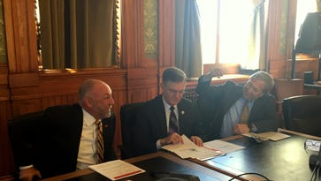 Iowa's three state university presidents visit Wednesday prior to meeting with a House-Senate budget panel in Des Moines. From left is Steven Leath of Iowa State University, Mark Nook of the University of Northern Iowa, and Bruce Harreld of the University of Iowa