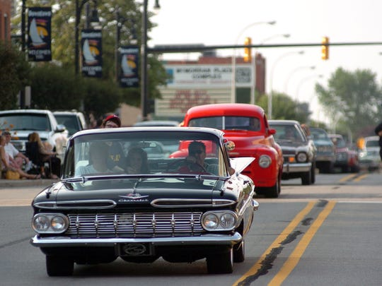 Cars make their way down Huron Avenue on July 6, 2012, during the 2012 Blue Water Open Cruise.