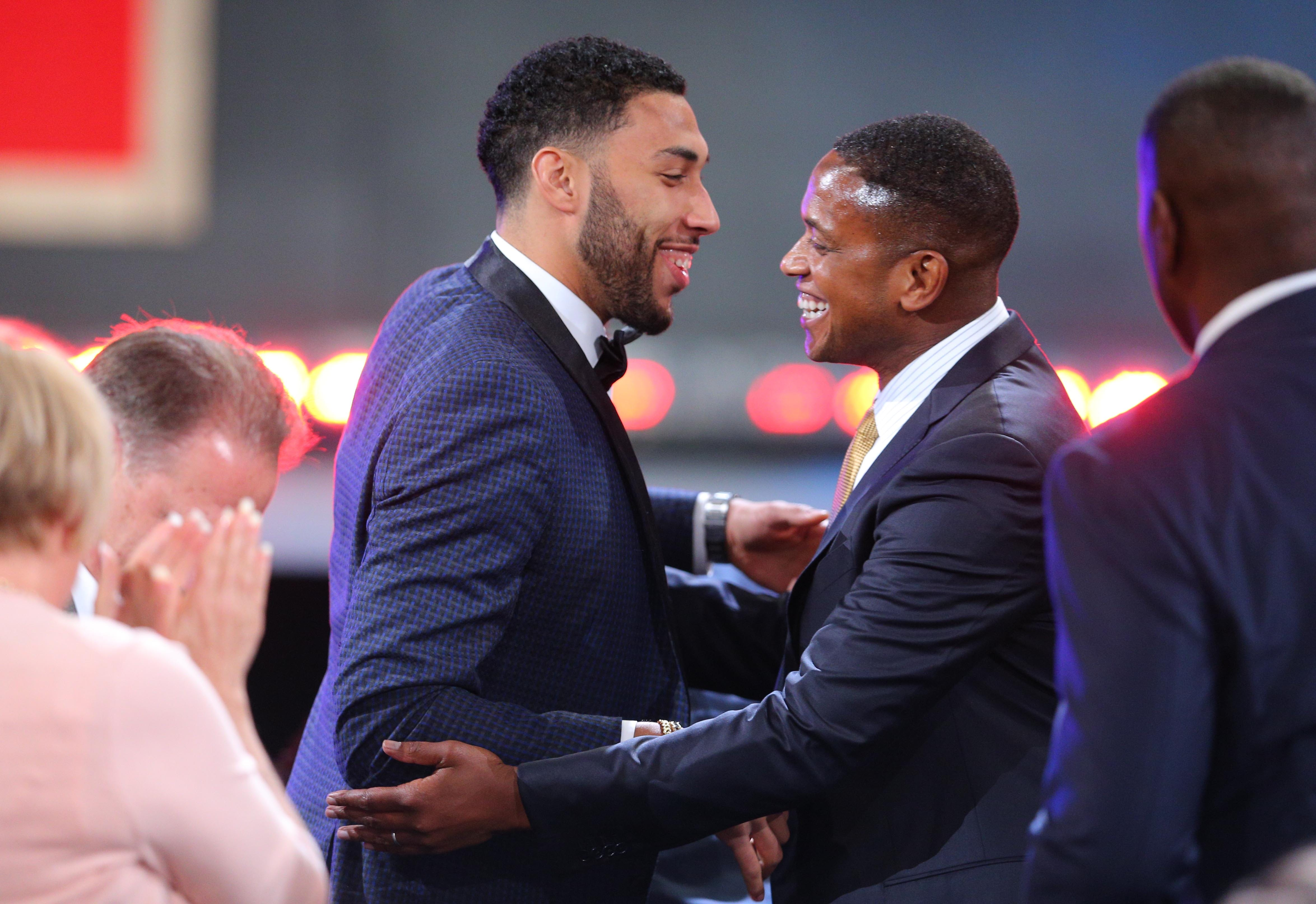 Denzel Valentine, Left, And Agent B.J. Armstrong Celebrate