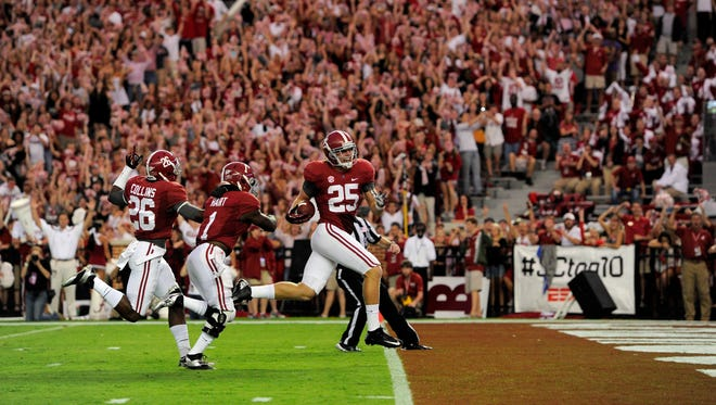 Alabama Crimson Tide linebacker Dillon Lee (25) , defensive back Landon Collins (26) and running back Dee Hart (1) recover a blocked punt against the Colorado State Rams at Bryant-Denny Stadium. Alabama Crimson Tide linebacker Dillon Lee (25) returned the recovered punt for a touchdown.