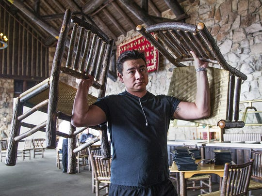 Restaurant server assistant Ronnie Whitehorn removes chairs from the dining room to be stored for the winter at the North Rim when the Grand Canyon is closed for the winter.