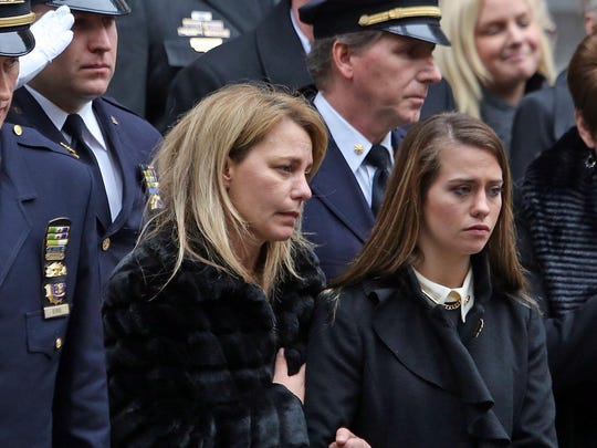 Christine Lemm, the wife of Joseph Lemm, and Lemm's daughter Brooke, 17, stand outside St. Patrick's Cathedral in Manhatan Dec. 30, 2015 after funeral mass for the West Harrison resident. Lemm, an NYPD member, and a member of the Air National Guard, was killed fighting in Afghanistan in Dec. 21.