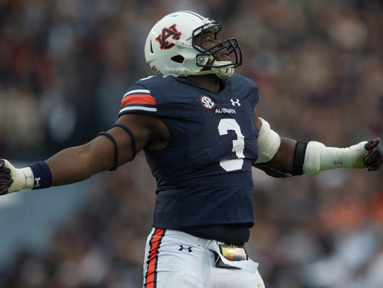 Auburn defensive lineman Marlon Davidson (3) celebrates