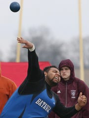Anthony Ray, Batavia, hurls the shot on his third throw in the boys shot put.