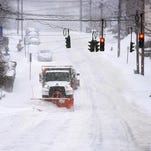 A City of Poughkeepie truck plows Washington Street on Monday in the city. Feb. 2, 2015
