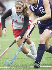 Abby Wagner (left) battles for the ball while playing for Susquehannock in 2008.