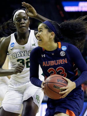 Auburn forward Jessica Jones (23) is defended by Baylor center Beatrice Mompremier (32) during the first half of a second-round women's college basketball game in the NCAA Tournament Sunday, March 20, 2016, in Waco, Texas.