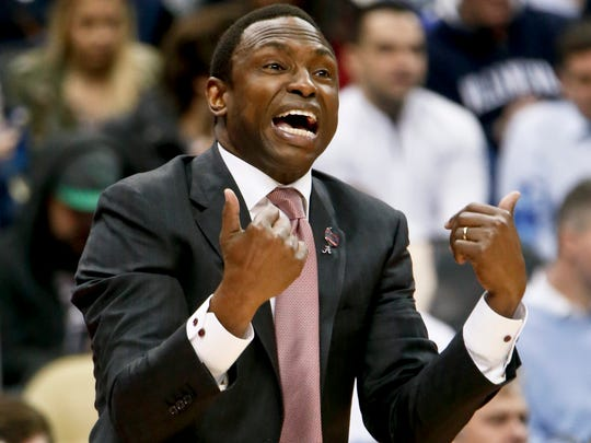 Alabama coach Avery Johnson yells to his team during