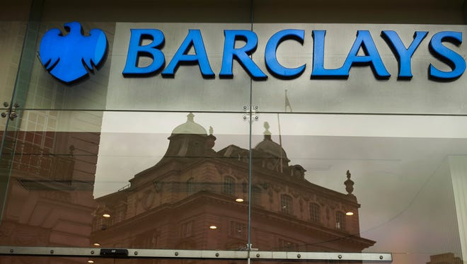 File photo taken in 2012 shows the logo of the British bank Barclays on a sign outside a branch in London.