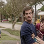 """In this image released by Broad Green Pictures, Andrew Garfield portrays Dennis Nash, center, Michael Shannon portrays Rick Carver, left, and Noah Lomas portrays Connor Nash in a scene from """"99 Homes."""""""