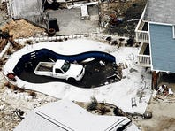 A truck sits in a pool after Hurricane Ivan.