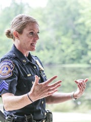 IMPD Lt. Catherine Cummings talks with team members during a gathering of Mobile Crisis Assistance Team members at Eagle Creek Park on July 20, 2017. Cummings is a supervisor who helped launch MCAT.