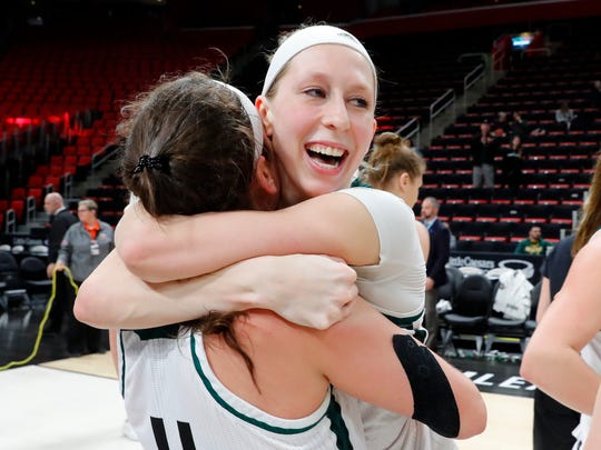 Green Bay's Allie LeClaire, right, celebrates with teammate Caitlyn Hibner after defeating Wright State in the Horizon League tournament championship at LCA.
